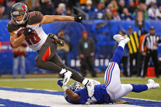 "FILE - In this Nov. 18, 2018, file photo, Tampa Bay Buccaneers wide receiver Adam Humphries (10) scores a touchdown against the New York Giants during an NFL football game, in East Rutherford, N.J. For Adam Humphries, Tennessee has been a potential destination for months based on his relationship with Titans general manager Jon Robinson because of their Tampa Bay connection. Not even a late push by the New England Patriots could sway him to walk away from his deal with the Titans. Even considering how much success wide receivers like Humphries have enjoyed with the defending Super Bowl champs.""Obviously, I'm a man of my word, and I'm going to keep my word there,"" Humphries said Thursday, March 14, 2019, after signing with Tennessee. (AP Photo/Adam Hunger, File)"