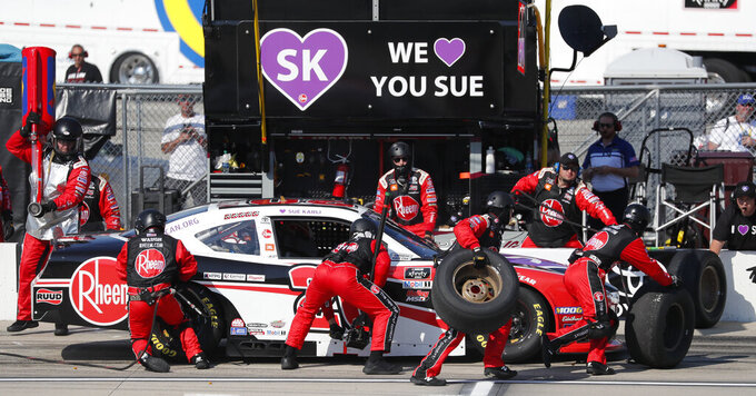 Christopher Bell's crew change tires on pit road during a NASCAR Xfinity Series auto race, Saturday, July 27, 2019, at Iowa Speedway in Newton, Iowa. (AP Photo/Matthew Putney)