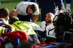 Dallas Cowboys quarterback Dak Prescott, right, looks off as first responders and team medical personnel assist Prescott after he suffered a lower right leg injury running the ball against the New York Giants in the second half of an NFL football game in Arlington, Texas, Sunday, Oct. 11, 2020. (AP Photo/Michael Ainsworth)
