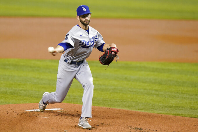 Los Angeles Dodgers' Jake Reed delivers a pitch during the first inning of the team's baseball game against the Miami Marlins, Wednesday, July 7, 2021, in Miami. (AP Photo/Wilfredo Lee)