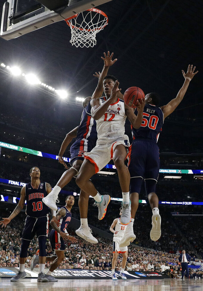 Virginia's De'Andre Hunter (12) goes up for a shot during the second half in the semifinals of the Final Four NCAA college basketball tournament against Auburn, Saturday, April 6, 2019, in Minneapolis. (AP Photo/David J. Phillip)