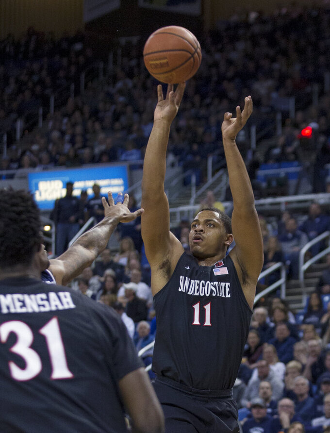 San Diego State forward Matt Mitchell (11) shoots against Nevada in the first half of an NCAA college basketball game in Reno, Nev., Saturday, March 9, 2019. (AP Photo/Tom R. Smedes)