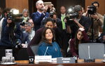 Cameras follow Jody Wilson Raybould as she waits to appear in front of the Justice committee in Ottawa, Wednesday February 27, 2019. Wilson Raybould is testifying she experienced a consistent and sustained effort by many people in Prime Minister Justin Trudeau's government to inappropriately interfere in the prosecution of a major Canadian engineering company (Adrian Wyld/The Canadian Press via AP)