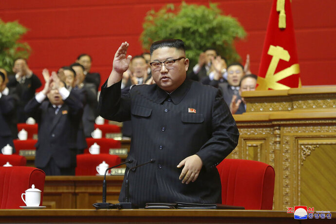 In this photo provided by the North Korean government, North Korean leader Kim Jong Un acknowledges to the applauds after he made his closing remarks at a ruling party congress in Pyongyang, North Korea Tuesday, Jan. 12, 2021. Kim vowed all-out efforts to bolster his country's nuclear deterrent during the major ruling party meeting where he earlier laid out plans to work toward salvaging the broken economy. Independent journalists were not given access to cover the event depicted in this image distributed by the North Korean government. The content of this image is as provided and cannot be independently verified. Korean language watermark on image as provided by source reads: