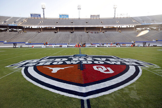"""FILE - In this Oct. 10, 2020, file photo, The Red River Showdown logo is displayed on the field of the Cotton Bowl, prior to an NCAA college football game between the University of Texas and Oklahoma, in Dallas. Texas and Oklahoma made a request Tuesday, July 27, 2021, to join the Southeastern Conference — in 2025 —- with SEC Commissioner Greg Sankey saying the league would consider it in the """"near future."""" (AP Photo/Michael Ainsworth, File)"""