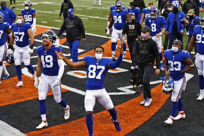 New York Giants wide receiver Sterling Shepard (87) celebrates after the Giants defeated the Cincinnati Bengals in an NFL football game, Sunday, Nov. 29, 2020, in Cincinnati. (AP Photo/Aaron Doster)