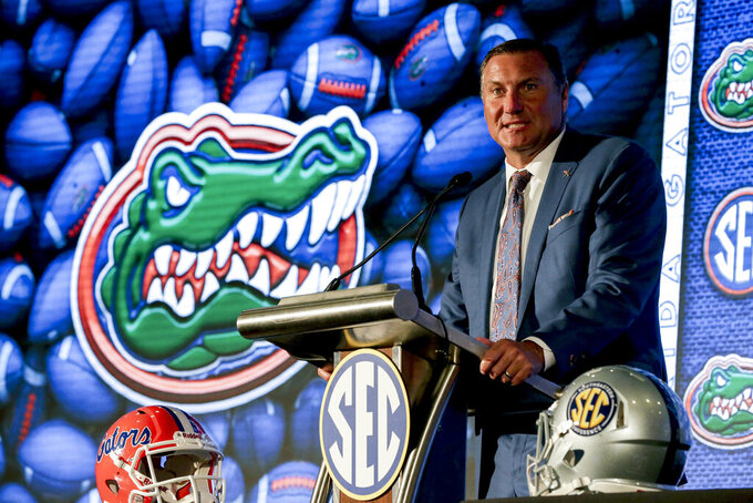Florida head coach Dan Mullen speaks to reporters during the NCAA college football Southeastern Conference Media Days Monday, July 19, 2021, in Hoover, Ala. (AP Photo/Butch Dill)