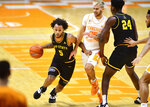 Appalachian State guard Michael Almonacy (5) dribbles the ball during an NCAA college basketball game against Tennessee in Knoxville, Tenn., on Tuesday, Dec. 15, 2020.  (Brianna Paciorka/Knoxville News Sentinel via AP)