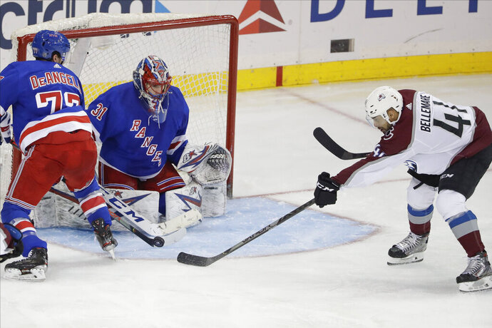 New York Rangers goaltender Igor Shesterkin (31) stops a shot by Colorado Avalanche's Pierre-Edouard Bellemare (41) during the third period of an NHL hockey game Tuesday, Jan. 7, 2020, in New York. The Rangers won 5-3. (AP Photo/Frank Franklin II)