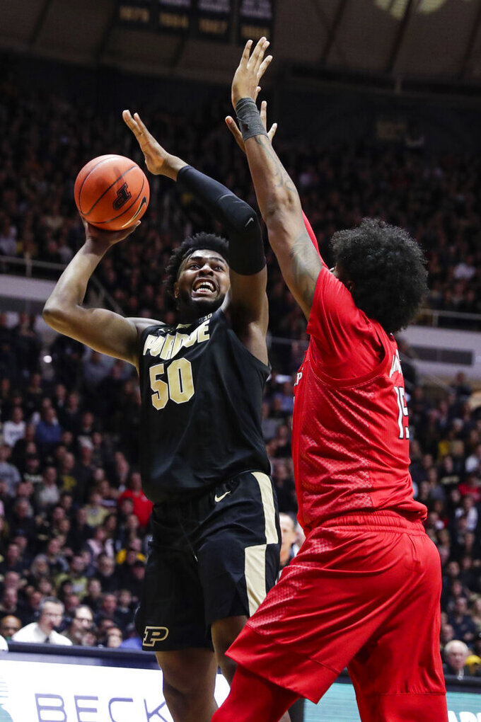 Purdue forward Trevion Williams (50) shoots over Rutgers center Myles Johnson (15) during the second half of an NCAA college basketball game in West Lafayette, Ind., Saturday, March 7, 2020. Rutgers defeated Purdue 71-68 in overtime. (AP Photo/Michael Conroy)