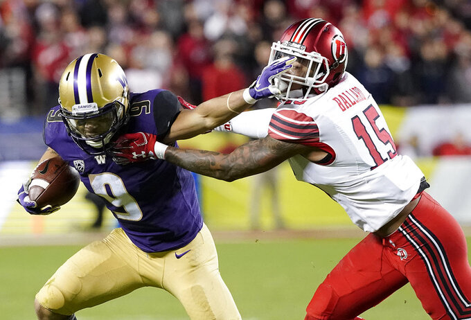 Washington running back Myles Gaskin (9) runs against Utah defensive back Corrion Ballard (15) during the first half of the Pac-12 Conference championship NCAA college football game in Santa Clara, Calif., Friday, Nov. 30, 2018. (AP Photo/Tony Avelar)