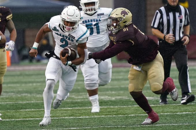 Coastal Carolina's Reese White (2) runs past Texas State's Jordan Revels (91) during the first half of an NCAA college football game in San Marcos, Texas, Saturday, Nov. 28, 2020. (AP Photo/Chuck Burton)
