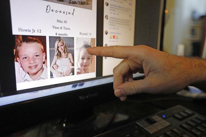 FILE - In this Tuesday, Nov. 5, 2019, file photo, Austin Cloes points to a photo of his relative Rhonita Miller and her family, who were killed in Mexico, on a computer screen, in Herriman, Utah. The recent slaying in Mexico of nine people who belonged to a Mormon offshoot community where some people practice polygamy shines a new spotlight on the ongoing struggle for the mainstream church to fight the association with plural marriage groups because of its past. (AP Photo/Rick Bowmer, File)