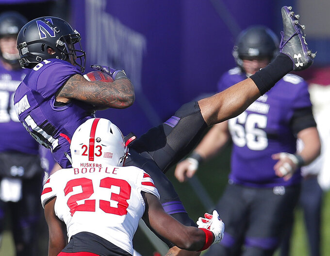 Northwestern's Ramaud Chiaokhiao-Bowman, top, makes a catch next to Nebraska's Dicaprio Bootle during the second half of an NCAA college football game Saturday, Oct. 13, 2018, in Evanston, Ill.. (AP Photo/Jim Young)