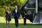 President Joe Biden and first lady Jill Biden walk on the South Lawn of the White House after stepping off Marine One, Sunday, June 27, 2021, in Washington. (AP Photo/Patrick Semansky)