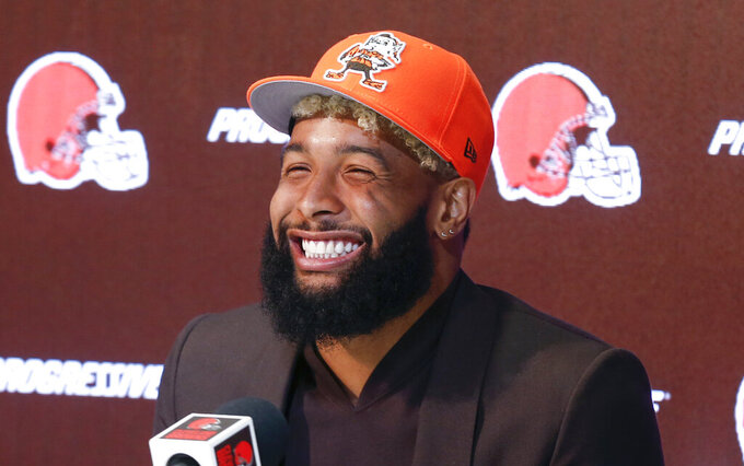 FLE - In this April 1, 2019, file photo, Cleveland Browns' Odell Beckham answers questions during a news conference in Berea, Ohio. Odell Beckham Jr.'s got a new team and a new ride. The star wide receiver has purchased a tricked-out, orange Rolls Royce complete with a pop-up hood ornament that features a miniaturized model of him in a Browns uniform making one of the one-handed catches he became known for while with the Giants. (AP Photo/Ron Schwane, File)
