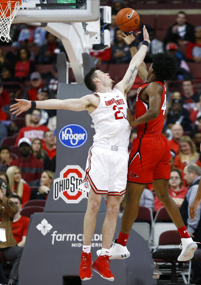Southeast Missouri State's Darrious Agnew, right, tries to shoot over Ohio State's Kyle Young during the second half of an NCAA college basketball game Tuesday, Dec. 17, 2019, in Columbus, Ohio. Ohio State defeated Southeast Missouri State 80-48. (AP Photo/Jay LaPrete)