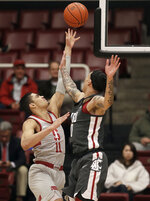 Stanford forward Jaiden Delaire, left, shoots against Washington State forward Isaiah Wade during the first half of an NCAA college basketball game in Stanford, Calif., Thursday, Feb. 28, 2019. (AP Photo/Jeff Chiu)