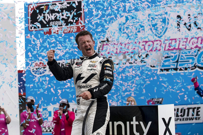 NASCAR Xfinity Series driver AJ Allmendinger (16) celebrates in victory lane after winning the NASCAR Xfinity auto race at the Charlotte Motor Speedway Saturday, Oct. 9, 2021, in Concord, N.C. (AP Photo/Matt Kelley)