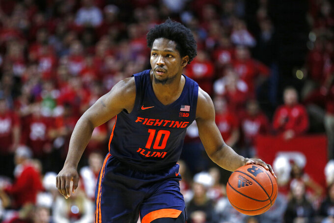 Illinois guard Andres Feliz (10) looks to pass during the first half of an NCAA college basketball game against Rutgers, Saturday, Feb. 15, 2020, in Piscataway, N.J. (AP Photo/Adam Hunger)