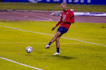 United States head coach Gregg Berhalter kicks the ball during a training session ahead of the FIFA World Cup Qatar 2022 qualifying soccer match between Honduras and United States in San Pedro Sula, Honduras, Tuesday, Sept. 7, 2021. (AP Photo/Moises Castillo)