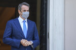 Greek Prime Minister Kyriakos Mitsotakis looks on as he waits for the arrival of his Lithuanian counterpart Ingrida Simonyte prior their meeting in Athens, on Thursday, July 15, 2021. (AP Photo/Petros Giannakouris)