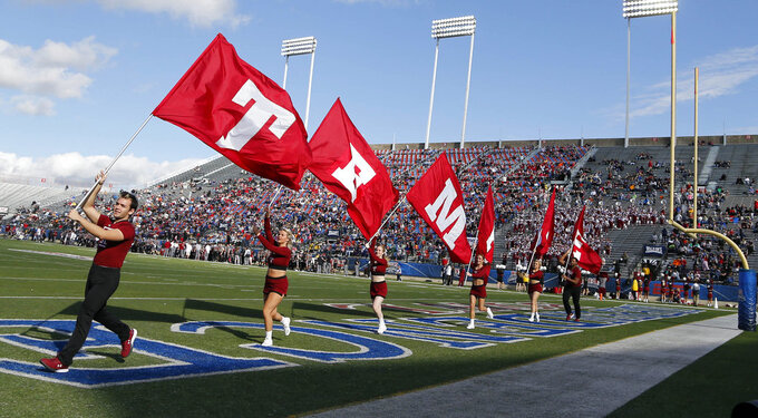 Temple cheerleaders celebrate a first-half score against Duke in the Independence Bowl NCAA college football game in Shreveport, La., Thursday, Dec. 27, 2018. (AP Photo/Rogelio V. Solis)