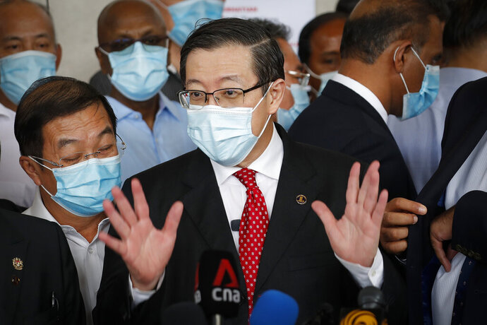 Former finance minister Lim Guan Eng speaks to media outside court house in Kuala Lumpur, Friday, Aug. 7, 2020. Lim has been charged with corruption over a $1.5 billion undersea tunnel project. Lim was part of a reformist government ousted in March, and his party slammed the criminal charge as political persecution by the new government. (AP Photo/Vincent Thian)