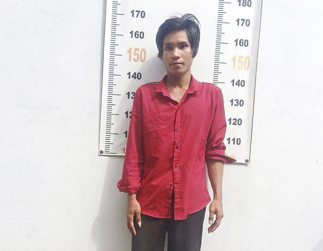 Nhel Thearina poses for a photo at the police station after his arrest in the eastern province of Tbong Khmum, Cambodia on Tuesday, Sept. 8, 2020. Police said Thursday that the young Cambodian, popular for posting videos on the Tik-Tok social media platform, was arrested after putting an insult online about the country's revered Angkor Wat temple, and is being detained even though he quickly deleted his controversial clip and posted an apology. (Tbong Khmum Police via AP)