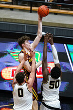 Minnesota center Liam Robbins (0) shoots over Purdue forward Trevion Williams (50) and forward Mason Gillis (0) during the second half of an NCAA college basketball game in West Lafayette, Ind., Saturday, Jan. 30, 2021. (AP Photo/Michael Conroy)