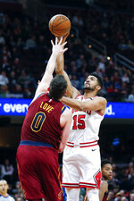 Chicago Bulls' Chandler Hutchison (15) shoots over Cleveland Cavaliers' Kevin Love (0) in the second half of an NBA basketball game, Saturday, Jan. 25, 2020, in Cleveland. The Bulls defeated the Cavaliers 118-106. (AP Photo/Ron Schwane)
