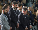 Edmonton Mayor Don Iveson, center left, Prime Minister Justin Trudeau, center, and Alberta Premier Jason Kenney pauses during a moment of silence during a memorial for the victims of the recent Ukrainian plane crash in Iran, in Edmonton, Sunday, Jan. 12, 2020. (Todd Korol/The Canadian Press via AP)