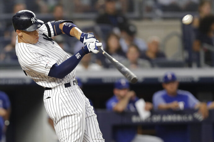 New York Yankees' Aaron Judge hits a two-run home run during the third inning of the team's baseball game against the Texas Rangers, Wednesday, Sept. 4, 2019, in New York. (AP Photo/Kathy Willens)