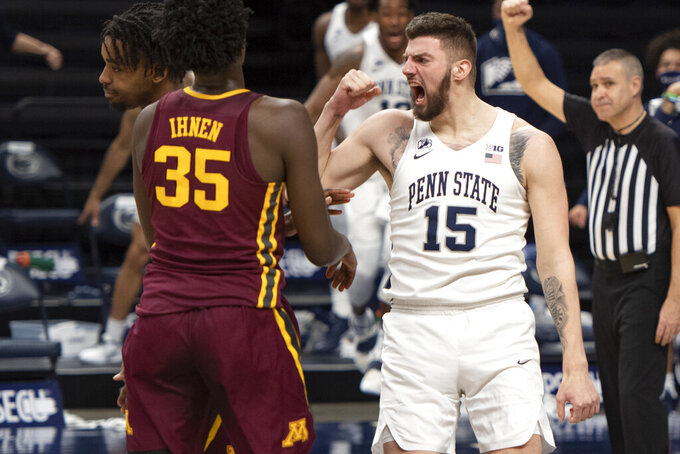 Penn State forward Trent Buttrick (15) reacts after dunking against Minnesota during an NCAA college basketball game Wednesday, March 3, 2021, in State College, Pa. (Noah Riffe/Centre Daily Times via AP)