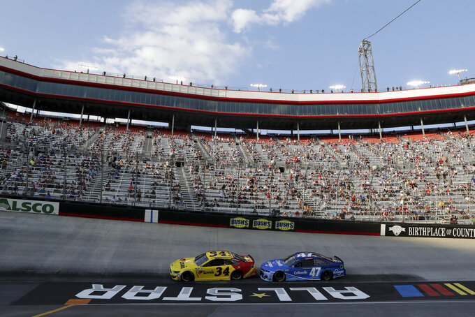 Michael McDowell (34) and Ricky Stenhouse Jr. (47) run during a NASCAR All-Star Open auto race at Bristol Motor Speedway in Bristol, Tenn, Wednesday, July 15, 2020. (AP Photo/Mark Humphrey)