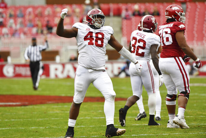 Alabama defensive lineman Phidarian Mathis (48) celebrates after sacking Arkansas quarterback Feleipe Franks during the first half of an NCAA college football game Saturday, Dec. 12, 2020, in Fayetteville, Ark. (AP Photo/Michael Woods)