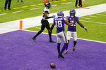 Minnesota Vikings wide receiver Justin Jefferson (18) celebrates with teammate Dalvin Cook, right, after catching a 20-yard touchdown pass during the second half of an NFL football game against the Jacksonville Jaguars, Sunday, Dec. 6, 2020, in Minneapolis. (AP Photo/Jim Mone)