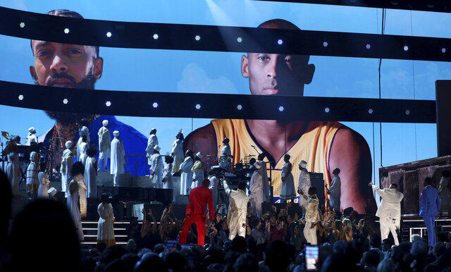 YG, from left, John Legend, Kirk Franklin, DJ Khaled and Meek Mill point to a screen showing Nipsey Hussle and Kobe Bryant during a tribute at the 62nd annual Grammy Awards on Sunday, Jan. 26, 2020, in Los Angeles. (Photo by Matt Sayles/Invision/AP)
