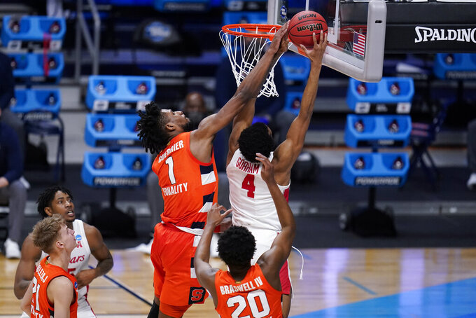 Houston forward Justin Gorham (4) shoots on Syracuse forward Quincy Guerrier (1) in the first half of a Sweet 16 game in the NCAA men's college basketball tournament at Hinkle Fieldhouse in Indianapolis, Saturday, March 27, 2021. (AP Photo/Michael Conroy)
