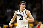FILE - In this Feb. 20, 2020, file photo, Iowa center Luka Garza celebrates after making a basket during the first half of an NCAA college basketball game against Ohio State in Iowa City, Iowa. Garza was selected the Associated Press Big Ten Player of the Year Tuesday, March 10, 2020. (AP Photo/Charlie Neibergall, File)