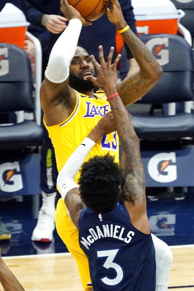 Los Angeles Lakers' LeBron James (23) shoots over Minnesota Timberwolves' Jaden McDaniels (3) in the second half of an NBA basketball game, Tuesday, Feb. 16, 2021, in Minneapolis. The Lakers won 112-104. (AP Photo/Jim Mone)