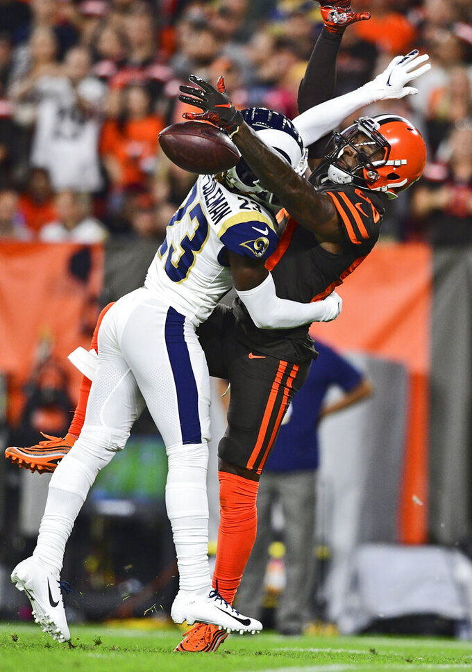 Los Angeles Rams defensive back Nickell Robey-Coleman (23) breaks up a pass to Cleveland Browns wide receiver Jarvis Landry (80) during the first half of an NFL football game Sunday, Sept. 22, 2019, in Cleveland. (AP Photo/David Dermer)