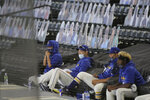 Seattle Mariners pitcher Yusei Kikuchi, second from left, sits with teammates above the dugout during the first inning of a baseball game against the Oakland Athletics, Sunday, Aug. 2, 2020, in Seattle. (AP Photo/Ted S. Warren)