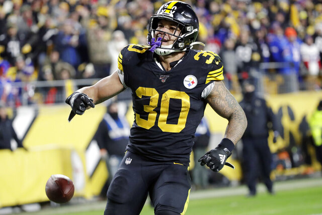 FILE - In this Dec. 15, 2019, file photo, Pittsburgh Steelers running back James Conner (30) plays during the second half of an NFL football game against the Buffalo Bills in Pittsburgh. Conner stressed he's not concerned about his future as he enters the final year of his contract. The team declined to offer him an extension following three seasons in which he has struggled to stay healthy.