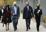 Toni Natalie, left, and India Oxenberg, right, arrive with their attorneys at Brooklyn federal court for a sentencing hearing for self-improvement guru Keith Raniere, Tuesday, Oct. 27, 2020 in New York. Raniere, whose organization NXIVM attracted millionaires and actresses among its adherents, is expected to be sentenced Tuesday on convictions that he turned some female followers into sex slaves branded with his initials. (AP Photo/Mark Lennihan)