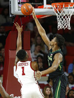 Baylor forward Flo Thamba, right, blocks a shot by Oklahoma guard Rashard Odomes (1) in the first half of an NCAA college basketball game in Norman, Okla., Monday, Jan. 28, 2019. (AP Photo/Sue Ogrocki)