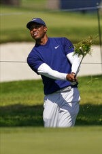Tiger Woods hits from the rough on the seventh hole during the third round of the PGA Championship golf tournament at TPC Harding Park Saturday, Aug. 8, 2020, in San Francisco. (AP Photo/Jeff Chiu)