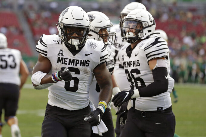 Memphis running back Patrick Taylor Jr. (6) celebrates his touchdown against South Florida during the first half of an NCAA college football game Saturday, Nov. 23, 2019, in Tampa, Fla. (AP Photo/Chris O'Meara)