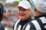 In this April 20, 2019, photo, Steve Shaw talks with a colleagues during Georgia's spring NCAA college football game in Athens, Ga. Officials are graded weekly on every play and those grades ultimately determine what conference they work. SEC officials have often worked their way up from the Sun Belt. Bowl assignments are determined by regular-season grades and poor grades can lead to demotions. Shaw, the national coordinator of football officials and the SEC's head of officiating, said last week at the conference spring meetings that eight officials won't be returning to the SEC this season. One moved on to the NFL and seven either retired or were not retained, Shaw said, declining to elaborate. (Gary McGriff via AP)
