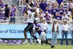 California wide receiver Kekoa Crawford (11) reaches up to haul in a pass as TCU cornerback Tre'Vius Hodges-Tomlinson (1) defends in the first half of an NCAA college football game in Fort Worth, Texas, Saturday, Sept. 11, 2021. (AP Photo/Tony Gutierrez)